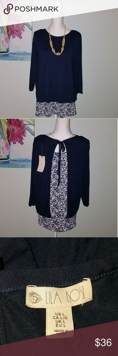 Lila Rose Navy and Floral 3/4 Top Size L NWT Lila Rose Navy and Floral 3/4 Top Size L NWT. Floral print sticks out the bottom and splits in the back. lila rose Tops