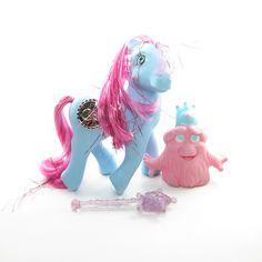 This vintage G1 My Little Pony is Princess Royal Blue, she's a Princess Pony from Year 5. Princess Royal Blue (called Princess Sapphire in the UK) is a blue earth pony and has bright pink hair with bi