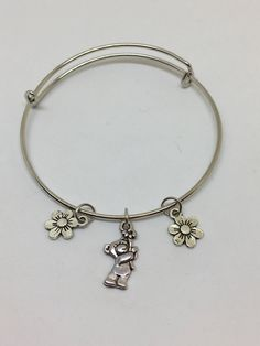 Flower and Teddy Bear Bangle Bracelet by Pinkarrowheadranch on Etsy https://www.etsy.com/listing/511224348/flower-and-teddy-bear-bangle-bracelet
