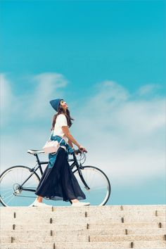 I love the bicycle, and the cute peaked cape, and the flowing skirt, and the comfy looking shoes, and the rich indigo and crisp white colour scheme. Japan Fashion, Look Fashion, Girl Fashion, Fashion Beauty, Mein Style, Cycle Chic, Bicycle Girl, Bike Style, Poses