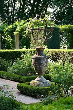 autour du cadran solairebuis autour du cadran solaire Spherical sculptural sundials on the Financial Times How to Spend it Stone sundial pedestal, possibly Irish, second hal. An armillary sphere stands at one end of the cypress-shaded swimming pool Formal Gardens, Outdoor Gardens, Small Gardens, Garden Wallpaper, Diy Jardin, English Garden Design, Formal Garden Design, Garden Urns, Herb Garden