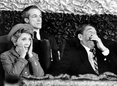 President Ronald Reagan roars with laughter as First Lady Nancy Reagan realizes she has forgotten to introduce him after she spoke to an inaugural tribute at the Capital Centre January 21, 1985