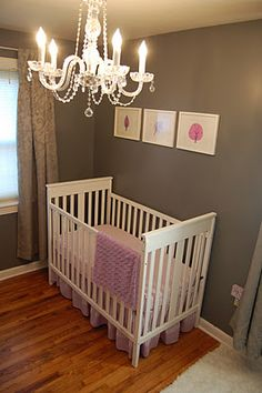 baby girls room: pink ultrasound and pink in brown squared frames