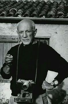 Pablo Picasso with his camera, date unknown