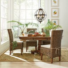 Woven Seagrass Side Chairs | Incredibly durable and rich in tonal variation, these unique dining chairs carry a coastal influence with their hardwood frames and seagrass woven seats and backs. Set of two.