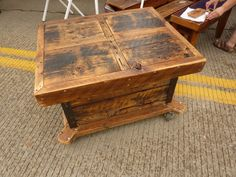 Items similar to Reclaimed Barnwood Large Storage Coffee Table Industrial casters on Etsy