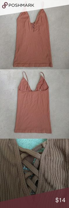 """Free People """"Crossfire"""" Crisscross Strappy Cami Only worn once! Cami in a stretchy seamless fabric with crisscross detailing at front. Adjustable straps. 92% nylon, 8% spandex. Made in the USA! Free People Tops Tank Tops"""
