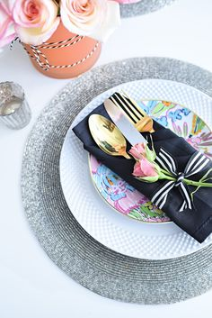 White dinnerware, gold flatware, and a simple floral and candle tablescape make a small space look grand and luxe for entertaining. So many great ideas in this post via monicawantsit.com #ad #BHGLiveBetter