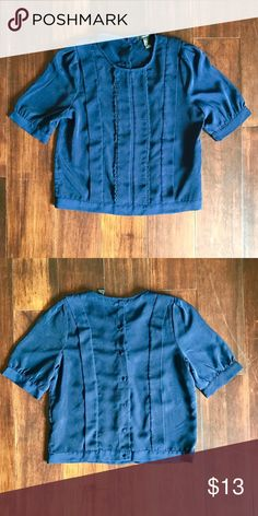 Forever 21 boxy tee with lace details The shirt is also a crop top, it's has a beautiful lacing details on the front. It's a loose fitted shirt, simple yet elegant. It's a deep navy blue color, the lighting on the phone just made it seem lighter Tops Blouses