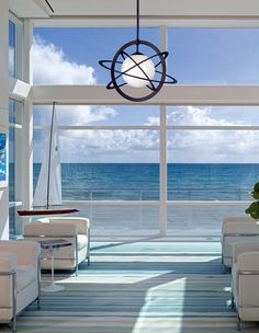 This minimal, modern living room is void of accents. It allows the ocean view to be the accent.
