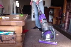 I never thought you could power slide a vacum cleaner round a table. Dyson DC25, great bit of design!
