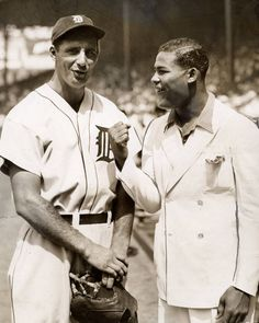 Detroit Tigers star Hank Greenberg and heavyweight boxer Joe Louis clown around pregame at Detroit's Navin Field, circa 1935.