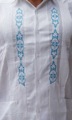 Only in Guayaberas Cubanas. Italian Linen. Best-Seller Guayabera for Wedding. Blue - Linen Guayabera for wedding. Italian Linen. Sublime soft fabric. This Guayabera is  manufactured by GuayaberasCubanas. Modern Fit. High Premium italian  Linen. Availability is subject to change. It may take 2 - 3 weeks to arrival. Normal Cuff. French cuff  available as request.  Available in Plus Size.  White & Blue Runs normal. Call for more information.