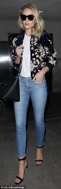 Lovely look: Adding some extra inches to her height, the beauty wore a pair of sky high black strappy sandals, with her jeans cropped to just above the ankle strap
