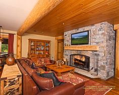 Basement family room in Ontario waterfront log home.  For more photos or this or any other or my homes, please check out my website, www.designma.com, my Design Page, www.facebook.com/loghomedesign, or Pinterest, http://www.pinterest.com/murrayarnott/murray-arnott-design  #ontariowaterfront #handcrafted #loghomedesign #loghomes