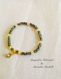Love this sweet little hematite/crystal/18k gold overlay stacking bracelet by Alexandra Marshall. #B2238. $19. To order, double click on photo.