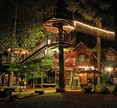 Great tree house at night with lights.