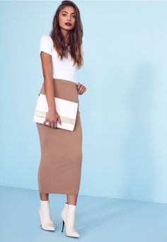 Amp up your curves with our bodycon long midi skirt. Coming to your ankle this tube fit skirt really makes you wiggle, you'll definitely turn heads in this sexy style. Team this sexy skirt with a nude body and nude skyscraper heels for styl...