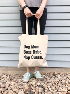 Dog Mom. Boss Babe. Nap Queen. These simply designed canvas tote bags will be the shopping bag you reach for time and time again. They are roomy enough to hold all your essentials but not so large that you feel like you're lugging a suitcase around. Made from lightweight cotton canvas, they are not only durable but both classic and trendy. 10% of your purchase is donated to help dogs in need at local animal shelters. Dog Mom Gifts, Dog Lover Gifts, Dog Lovers, Puppy Pictures, Dog Photos, Animal Shelters, Crazy Dog, Beautiful Dogs, Boss Babe