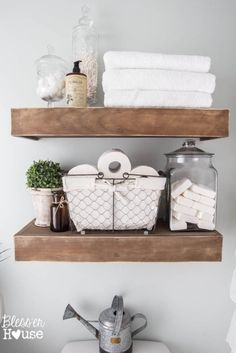 Bathroom open wood shelves, apothecary jars, wire basket, rustic glam bathroom ideas