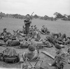 Once Upon a Time in War: Piper Bill Millin entertaining the men of 45 Royal Marine Commando, 1st Special Service Brigade, as they prepare for the invasion/3 June 1944.