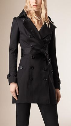 Burberry Black Cotton Sateen Trench Coat - The trench coat is crafted from cotton sateen, which has a lustrous appearance and smooth texture.  A closely cut design, the trench coat features set-in sleeves and a tapered waist.  Discover the women's outerwear collection at Burberry.com