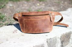 Fanny pack hand-made from genuine leather using only high-quality steel hardware. It has one big compartment and one pocket outside. Bag closes with