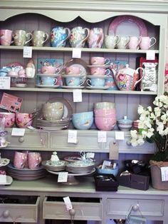 Good example of displaying a collection together. Lots of pieces but the pastel blue, pink and green tie everything together