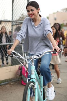 October 30: Selena seen riding a bike in Los Angeles, CA [HQs]