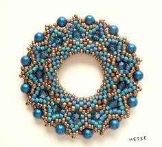 Beautiful photo of this ring of beads. Love the colours