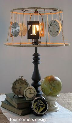 lamp diy:  Lampshade frame w/ hanging clocks, initials, other personal momentoes