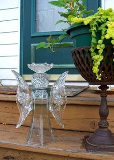 Sue Gerdes, of Flea2Fab says her garden angel is made from a glass bottle on a rod, with Star of David relish dishes for wings.