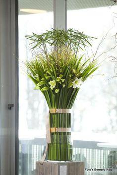 Lilies and Cyperus alternifolius arrangement -Florint: Swissflor 2012 - Luzern