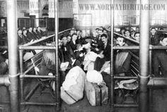 Immigrant pen, Ellis Island. These weary immigrants are awaiting the mandatory medical exam that will help determine if they are allowed entrance to the United States. Photo courtesy of www.norwayheritage.com.