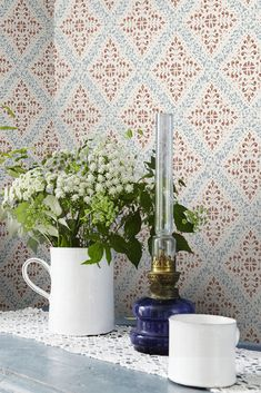 Based on a beautiful stencil pattern painted in our Nyborg wallpaper mingles three vividly lovely colours to create a truly enchanting end result. With its blue and terracotta patterns perfectly offset by their pale background, its rustic tones cre Cottage Wallpaper, Wallpaper Uk, Kitchen Wallpaper, Wallpaper Direct, Wallpaper Samples, Wallpaper Online, Designer Wallpaper, Pattern Wallpaper, Wallpaper Ideas