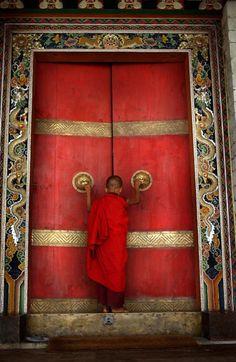 Buddhist Monk enters the Doors of Trongsa Dzong, Bumthang District, Bhutan The Doors, Windows And Doors, Bhutan, Little Buddha, Porte Cochere, When One Door Closes, Shangri La, Unique Doors, Door Knockers