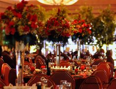 formal christmas banquet party elegant | She draped each rose filled centerpiece with black feathers and black ...