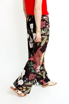 These black trousers are guaranteed to make an entrance thanks to their bold and colourful tropical print. They are cut in a wide-leg silhouette and feature side pockets and an elasticated waistband. Wear yours with a simple silk top for guaranteed sophistication. From Sienna With Love. Available at Sienna Boutique.