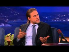 Charlie Hunnam~ he's wearing Christian Grey's gray tie! Well he can tie me up with it any time!