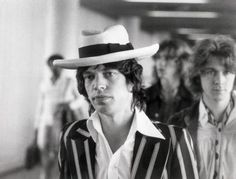 September 11th, 1973, Frankfurt, Germany —  (Original caption) A lot of young people will recognize this young man who has had a lot of influence in recent years. For the rest of us, this is Mick Jagger (and Mick Taylor on right) of the Rolling Stones. He's arriving in Frankfurt for the start of the German leg of his rock troupe's 1973 European tour. — Image by © Bettmann/CORBIS