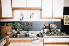 gloss black paint back splash :: Madelynn Furlong's Apartment via Miss Moss