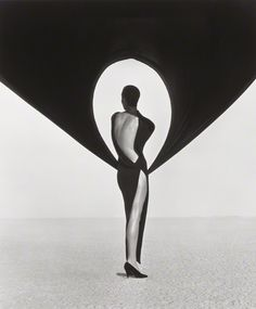 Versace Dress, Back View, El Mirage, Herb Ritts, 1990. Gelatin silver print, 24 x 20 in. The J. Paul Getty Museum, 2012.23.22. Gift of the Herb Ritts Foundation. © Herb Ritts Foundation via The Getty Iris where you can read more about the making of this photograph.