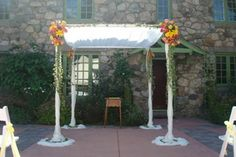 Stay cool outdoors with sheer fabric and fresh flowers. Decor/flowers by Stephanie's Floral Design in Melrose.
