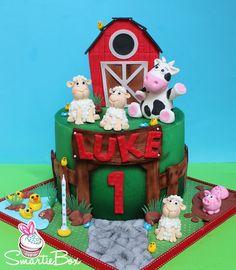 Farmyard cake with, barn, sheep, a cow, pigs and ducks- SmartieBox Cake Studio Farm Yard, Custom Cakes, Sheep, Gingerbread, Cake Decorating, Cow, Christmas Ornaments, Studio, Pigs