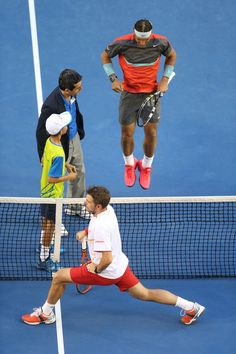 Rafael Nadal (top) of Spain and Stanislas Wawrinka of Switzerland stretch ahead of their final match during day 14 of the 2014 Australian Op...