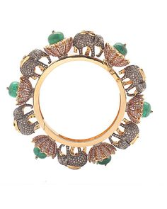 Love the lotus and and elephant pairing on this modern bangle crafted in 18 K gold and set with emeralds, uncut diamonds, coffee diamonds and round brilliant diamonds. Anmol Jewellers, Mumbai and Delhi India Jewelry, Jewelry Gifts, Fine Jewelry, African Jewelry, Gold Jewelry, Handmade Jewelry, Elephant Jewelry, Elephant Bracelet, Art Ancien