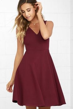 Welcome the Hello World Wine Red Midi Dress into your heart and your wardrobe! Medium-weight stretch knit forms a sleeveless bodice with a V-neckline and princess seams. A flirty midi-length, skater skirt falls from the fitted waist. Hidden back zipper/clasp.