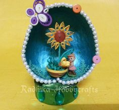 Quilled flower pot in Coconut shell !