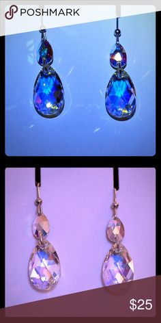 Swarovski crystal and silver earrings It looks blue but is actually clear and extremely shining with the light. Jewelry
