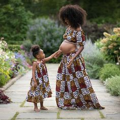 Choose from the best and beautiful matching African ankara styles for mother and daughter. These ankara styles are meant for stunning mother and daughter Ankara Clothing, African Print Clothing, Ankara Gowns, Maternity Pictures, Pregnancy Photos, Dear Daughter, Pregnant Mother, Maternity Gowns, Ankara Styles